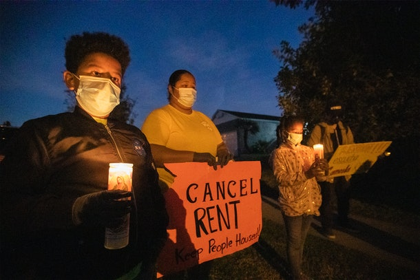 Lakewood, CA - December 16:  Kennia Viera, center, of Los Angeles, who is a single mom, unemployed and in danger of being evicted at the end of January, protests with her kids, Florisabella Houston-Viera, 7, second from right, and Enrique Houston-Viera, 9, left, after speaking at a protest for tenants in danger of eviction because of the financial fallout of the coronavirus pandemic. The protestors take part in a ``posada'' protest outside the home of Assembly Speaker Anthony Rendon, D-Lakewood, to urge him to support AB 15 and AB 16 in on Wednesday, Dec. 16, 2020 in Lakewood, CA. The pair of bills would extend eviction protections for tenants and ensure COVID-19 debt relief for struggling tenants and landlords. Demonstrators, who also protested outside Rendons future office, re-enacted Joseph and Mary's journey from Nazareth to Bethlehem in search of safe refuge so Mary could give birth to Jesus. (Allen J. Schaben / Los Angeles Times via Getty Images)
