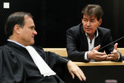 Former Belgian politician Bernard Wesphael (R) speaks to his lawyer Jean-Philippe Mayence at the sta...