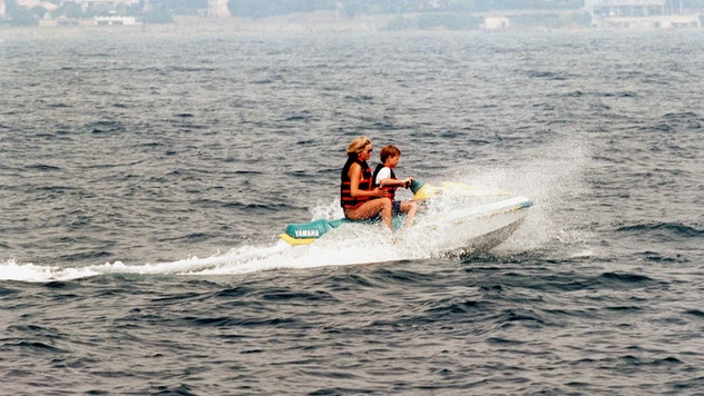 Princess Diana and Prince Harry try out a jet ski in 1997.