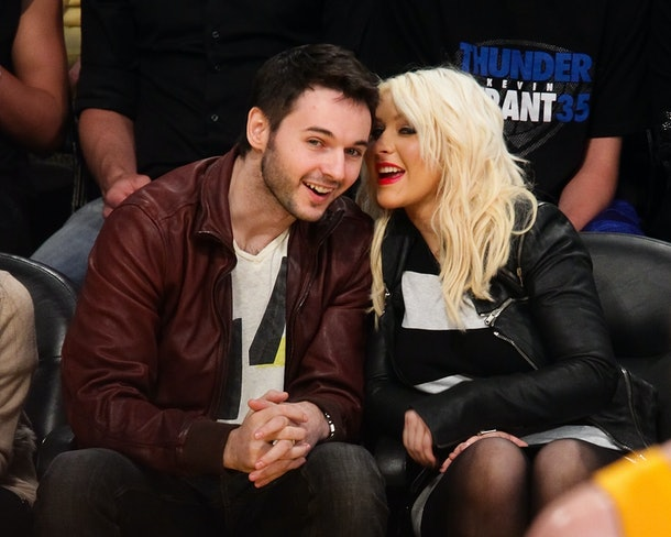 LOS ANGELES, CA - MARCH 29:  Matt Rutler (L) and Christina Aguilera attend a basketball game between the Oklahoma City Thunder and the Los Angeles Lakers at Staples Center on March 29, 2012 in Los Angeles, California.  (Photo by Noel Vasquez/Getty Images)