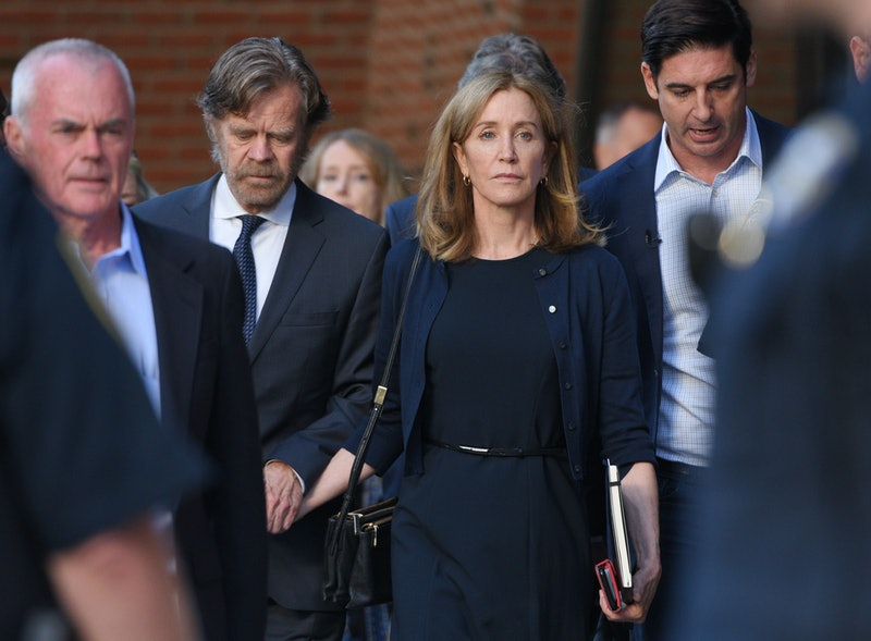 BOSTON, MA- SEPTEMBER, 13, 2019:   William H. Macy leaves Moakley Federal Courthouse with his wife Felicity Huffman who was sentenced to 14 days in prison for the college admission scam on September 13, 2019 (Staff Photo By Faith Ninivaggi/ Boston Herald/Media News Group) ( Photo by Faith Ninivaggi/Boston Herald/Media News Group/MediaNews Group/Boston Herald via Getty Images)