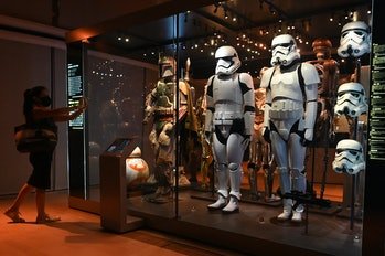 A visitor takes a photo of life-sized figures of stormtroopers from the Star Wars series displayed a...