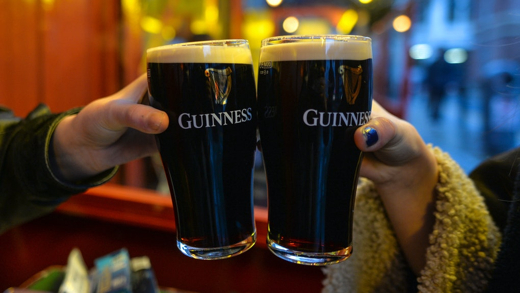 People enjoy a pint of Guinness on a bar-restaurant terasse in Dublin's city center. On Wednesday, December 23, 2020, in Dublin, Ireland. (Photo by Artur Widak/NurPhoto via Getty Images)