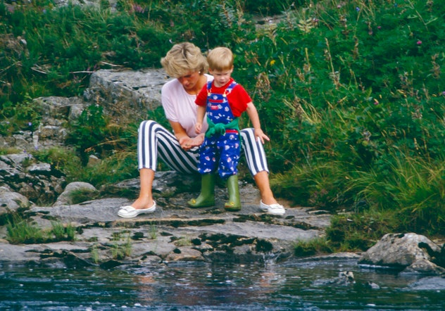 Princess Diana at the river in Balmoral with Prince Harry.