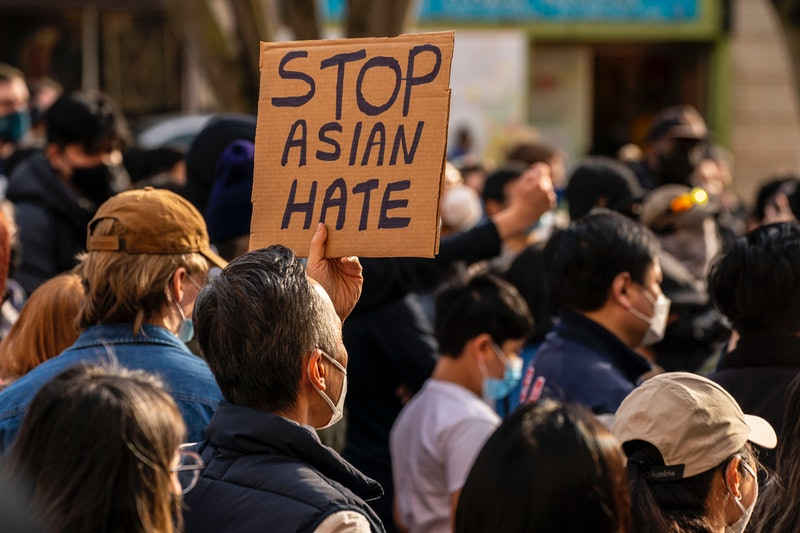 "SEATTLE, WA - MARCH 13: Demonstrators gather in the Chinatown-International District for a ""We Are Not Silent"" rally and march against anti-Asian hate and bias on March 13, 2021 in Seattle, Washington. Following recent attacks on Asian Americans and Pacific Islanders in Seattle and across the U.S., rally organizers planned several days of actions in the Seattle area. (Photo by David Ryder/Getty Images)"