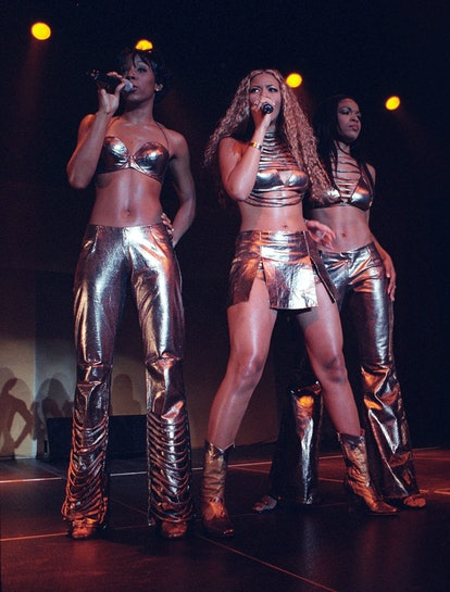 SYDNEY, AUSTRALIA - SEPTEMBER 15:  (L-R) Kelly Rowland,Beyonce Knowles and Michelle Williams of Destinys' Child perform live on stage at the Hordern Pavillion on July 18th, 2000 in Sydney, Australia.  (Photo by John Stanton/WireImage)