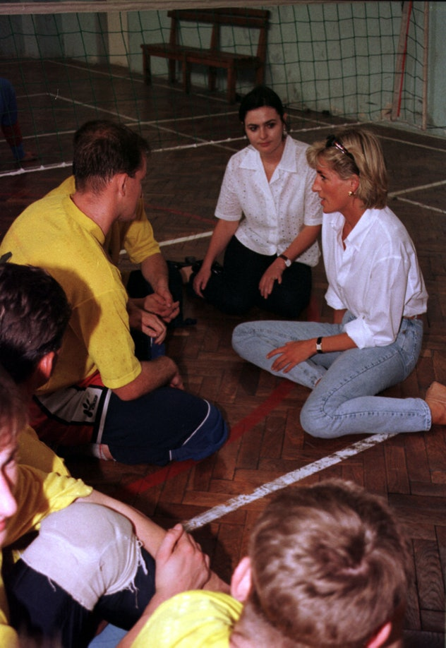 Princess Diana chats with volleyball players.