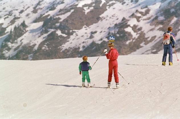 Princess Diana helps Prince Harry ski.