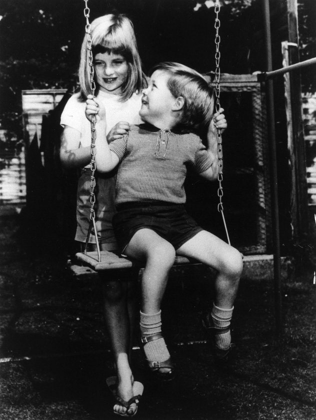 Diana Spencer pushes her brother on the swings.