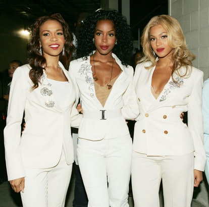 FOXBOROUGH, MA - SEPTEMBER 9:  (L-R) Singers Kelly Rowland, Beyonce Knowles and Michelle Williams of Destiny's Child pose before performing during the NFL opening game between the Indianapolis Colts vs the New England Patriots at Gillette Stadium on September 9, 2004 in Foxborough, Massachusetts.  (Photo by Frank Micelotta/Getty Images)