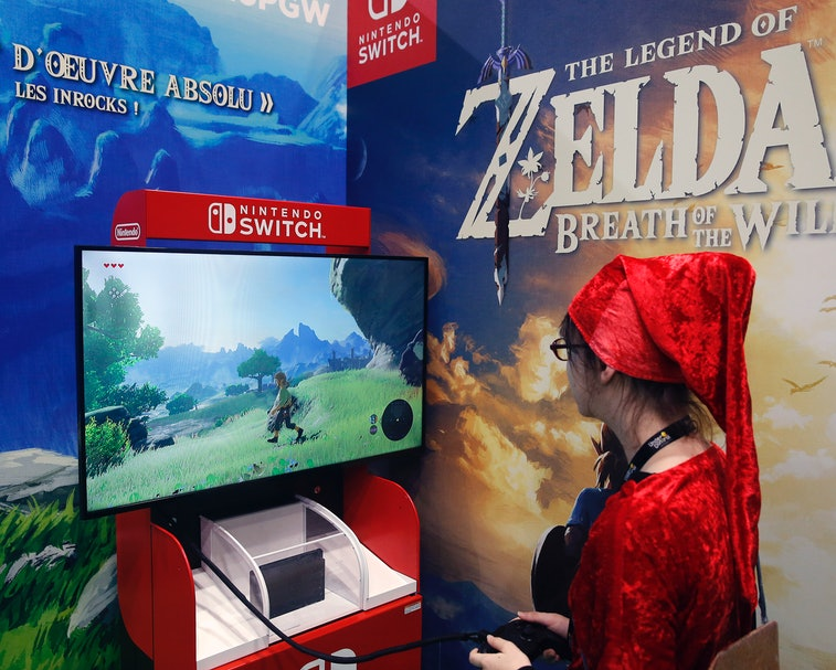 """PARIS, FRANCE - OCTOBER 31:  A gamer plays the video game """"The Legend of Zelda : Breath of the Wild""""..."""