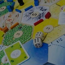 Utrecht, The Netherlands - July 4, 2011: Close-up Image of the famous board game The Settlers of Catan created by the German Klaus Teuber in 1995. In the game, players take the role of settlers and try to build and develop a settlement by trading resources with the other players.