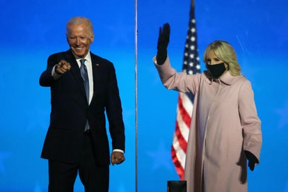 Jill Biden, wearing a pink Hiso coat, waves as her husband Democratic presidential nominee Joe Biden speaks during election night at the Chase Center in Wilmington, Delaware, early on November 4, 2020