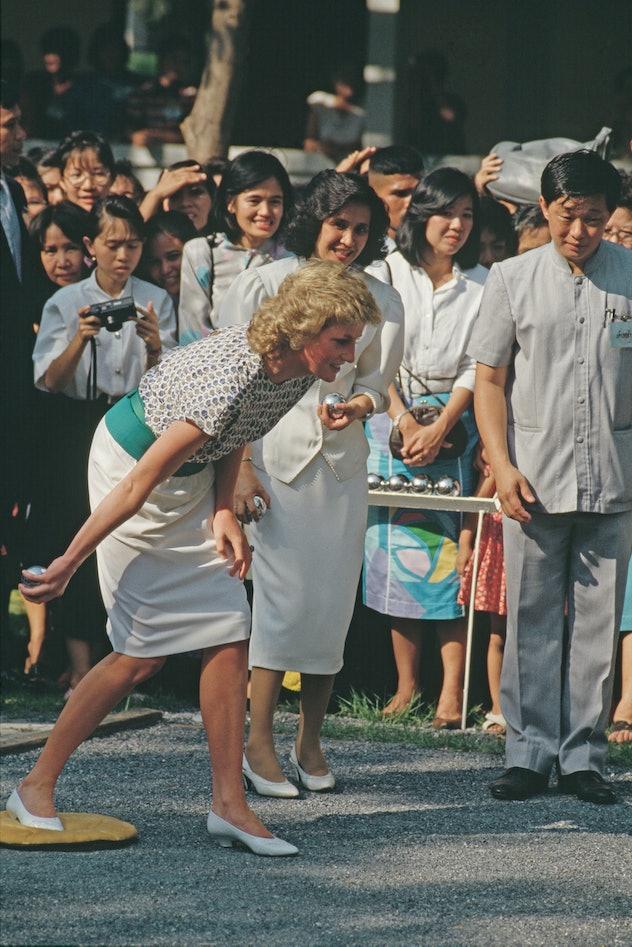 Princess Diana plays pétanque in Thailand in 1988.