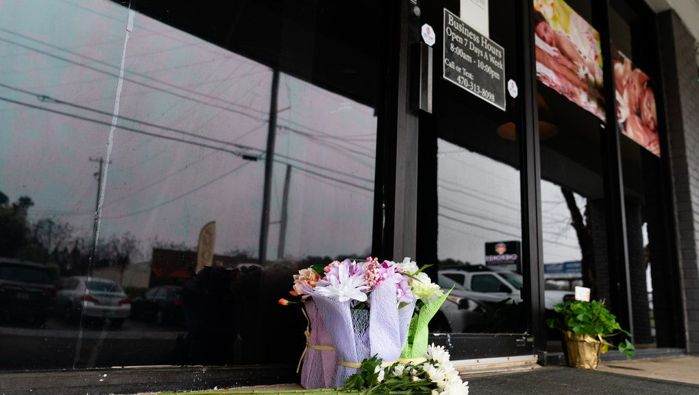 ACWORTH, GA - MARCH 17: Flowers are seen outside a massage parlor where four people were shot and killed on March 17, 2021 in Acworth, Georgia. Suspect Robert Aaron Long, 21, was arrested after a series of shootings at three Atlanta-area spas left eight people dead on Tuesday night, including six Asian women. (Photo by Elijah Nouvelage/Getty Images)