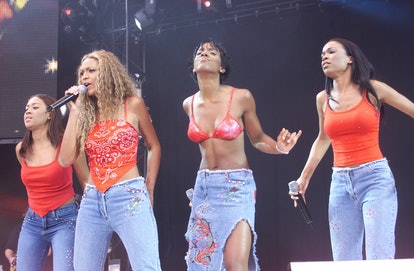 "LONDON - JULY 9: American pop group ""Destiny's Child"" perform on stage at ""Party In The Park"" held at Hyde Park on July 9, 2000 in London. (Photo by Dave Hogan/Getty Images)"