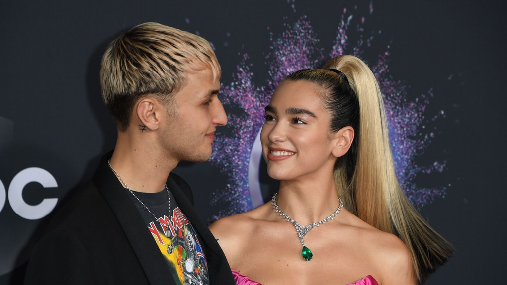British singer Dua Lipa and US model Anwar Hadid arrive for the 2019 American Music Awards at the Microsoft theatre on November 24, 2019 in Los Angeles. (Photo by Mark RALSTON / AFP) (Photo by MARK RALSTON/AFP via Getty Images)