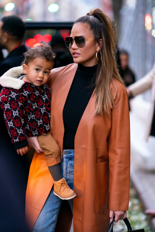 Chrissy Teigen tried to have a sexy photo shoot but her son Miles interrupted.