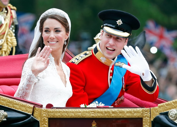 LONDON, UNITED KINGDOM - APRIL 29: (EMBARGOED FOR PUBLICATION IN UK NEWSPAPERS UNTIL 24 HOURS AFTER CREATE DATE AND TIME) Catherine, Duchess of Cambridge and Prince William, Duke of Cambridge (wearing his red tunic uniform of the Irish Guards, of which he is Colonel) travel down The Mall, on route to Buckingham Palace, in the 1902 State Landau horse drawn carriage following their wedding ceremony at Westminster Abbey on April 29, 2011 in London, England. The marriage of Prince William, the second in line to the British throne to Catherine Middleton was led by the Archbishop of Canterbury and was attended by 1900 guests, including foreign Royal family members and heads of state. Thousands of well-wishers from around the world have also flocked to London to witness the spectacle and pageantry of the Royal Wedding. (Photo by Max Mumby/Indigo/Getty Images)
