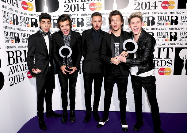 Zayn Malik, Harry Styles, Liam Payne, Louis Tomlinson and Nial Horan from One Direction with their Awards in the press room at the 2014 Brit Awards at the O2 Arena, London.   (Photo by Ian West/PA Images via Getty Images)