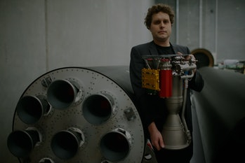 AUCKLAND, NEW ZEALAND - JUNE 10:  RocketLab CEO, Peter Beck poses with The Rutherford at the company's Auckland headquarters on June 10, 2015 in Auckland, New Zealand. The Rutherford, a battery-powered rocket engine printed on 3D parts developed by New Zealand space technology company, RocketLab, is set to reduce the cost for companies to send satellites to space by as much as US$5-45 million. Test flights will begin this year with a goal to provide commercial launch operations by 2016.  (Photo by Phil Walter/Getty Images)