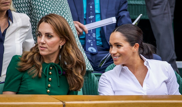 Catherine, Duchess of Cambridge sits with Meghan, Duchess of Sussex in the Royal Box on Centre Court ahead of the Ladies Singles Final between Simona Halep of Romania and Serena Williams of the United States on Centre Court during the Wimbledon Lawn Tennis Championships at the All England Lawn Tennis and Croquet Club at Wimbledon on July 13, 2019 in London, England.