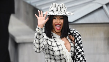 US rapper Cardi B waves as she arrives prior to the Chanel Women's Spring-Summer 2020 Ready-to-Wear ...