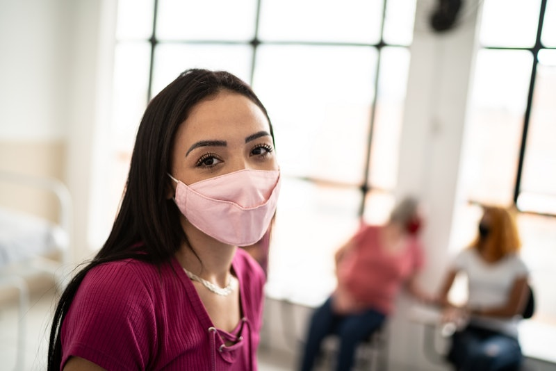 Doctors explain how long you'll be wearing your face mask for as COVID vaccines roll out.