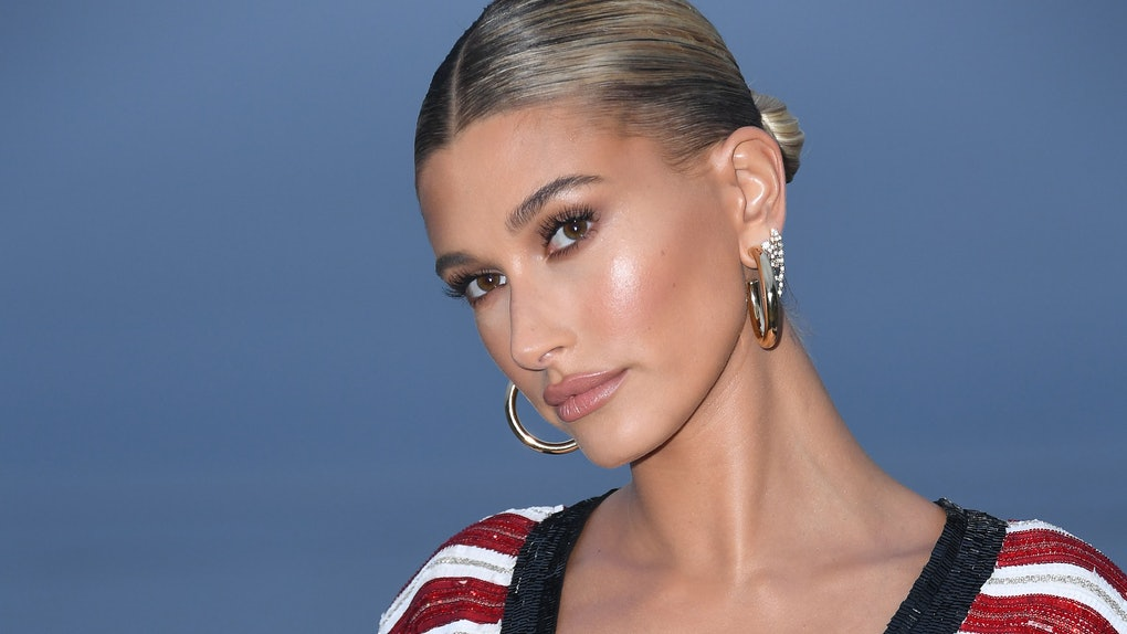 US model Hailey Baldwin arrives for the Saint Laurent Men's Spring-Summer 2020 runway show in Malibu, California, on June 6, 2019. (Photo by Valerie MACON / AFP)        (Photo credit should read VALERIE MACON/AFP via Getty Images)