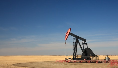 an oil pumpjacks in southern Alberta, Canada. This oilfield is located near Lethbridge.