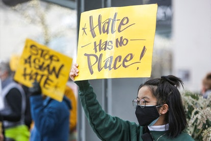 """A University of Washington student, who wished to remain anonymous, holds a sign that reads """"hate ha..."""