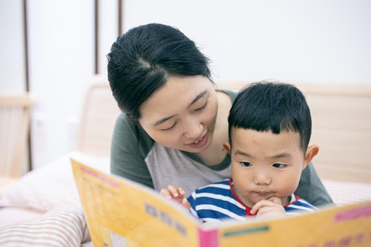 mom reading son a Bedtime story