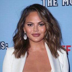 Chrissy Teigen's new hand tattoos are a chic take on the micro-ink trend.