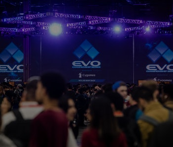 LAS VEGAS, NV - AUGUST 03:  Attendees walk between tournament games during day one of EVO 2018 at the Mandalay Bay Convention Center on August 3, 2018 in Las Vegas, Nevada.  (Photo by Joe Buglewicz/Getty Images)