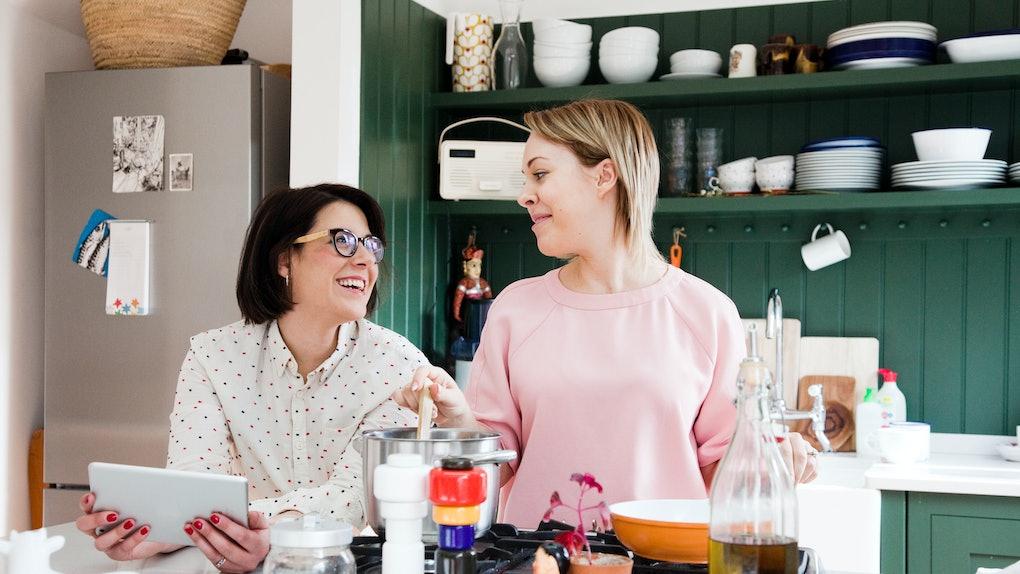 Two smiling women make TikTok Easter recipes using Peeps in their kitchen.
