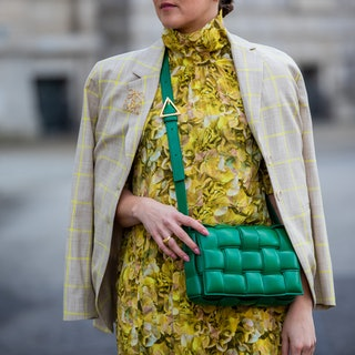 BERLIN, GERMANY - MARCH 15: Tina Haase is seen wearing yellow Baum & Pferdgarten dress with floral print and checkered blazer, green Bottega Veneta bag, Loewe brooch, green Bottega Veneta bag, Zara boots on March 15, 2021 in Berlin, Germany. (Photo by Christian Vierig/Getty Images)