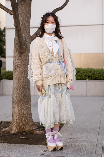 TOKYO, JAPAN - MARCH 15: A guest is seen on the street wearing Mikio Sakabe beige outfit with white ...