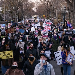 MINNEAPOLIS, MN - MARCH 18: People march through a neighborhood to protest against anti-Asian violen...