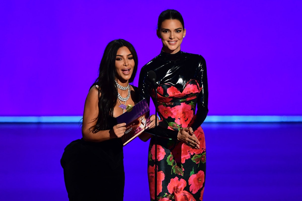 US television personalities Kim Kardashian (L) and Kendall Jenner present the award for Outstanding Competition Program onstage during the 71st Emmy Awards at the Microsoft Theatre in Los Angeles on September 22, 2019. (Photo by Frederic J. BROWN / AFP)        (Photo credit should read FREDERIC J. BROWN/AFP via Getty Images)