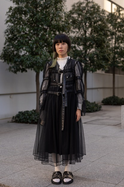 TOKYO, JAPAN - MARCH 15: A guest is seen on the street wearing black sheer dress with leather belts ...