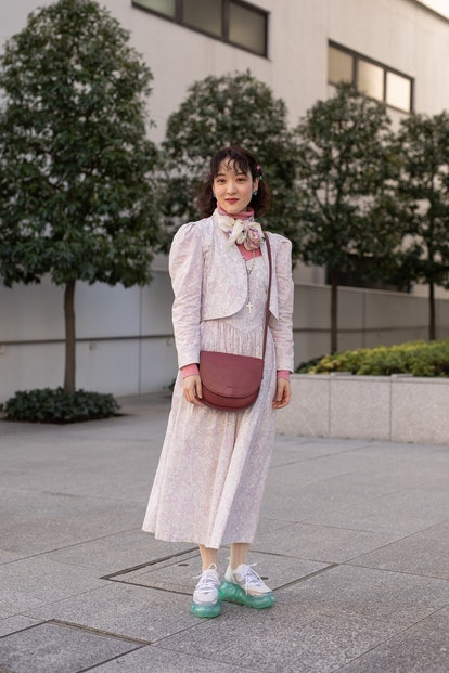 TOKYO, JAPAN - MARCH 15: A guest is seen on the street wearing pink floral print 2 piece vintage out...