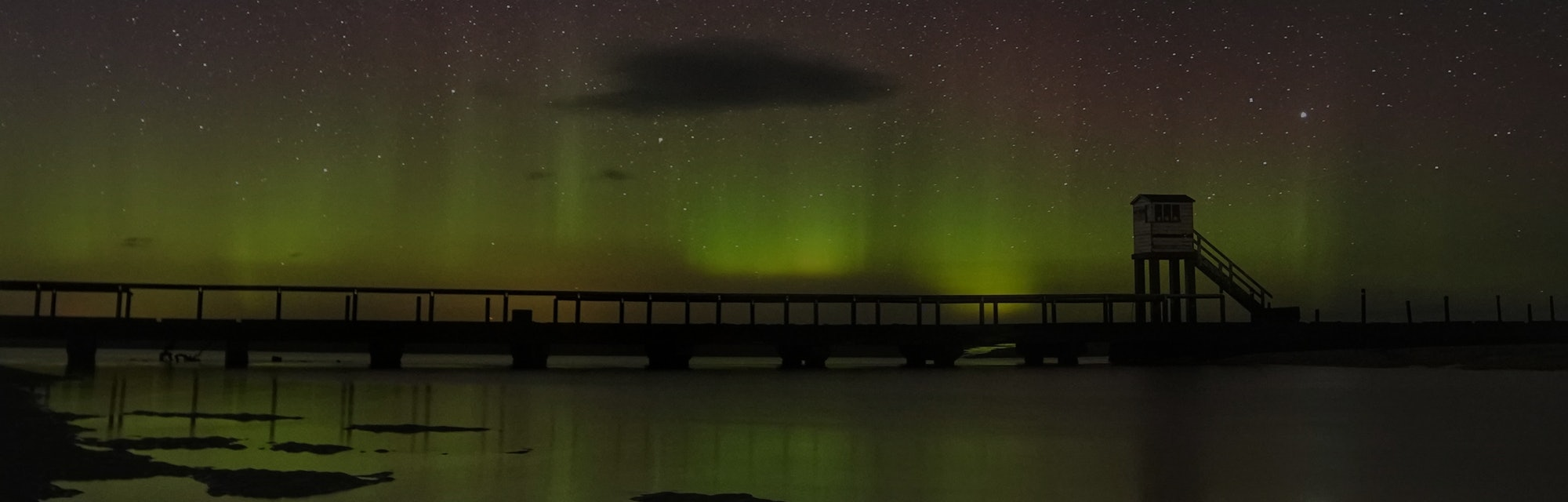 The Northern Lights and the Milky Way above the refuge hut where Holy Island in Northumberland is linked to the mainland by a long causeway where twice each day the incoming tide covers the road. Safe crossing times are displayed for motorists but when drivers get caught out they can take refuge in the hut and be rescued or wait for the next low tide. Picture date: Monday March 15, 2021. (Photo by Owen Humphreys/PA Images via Getty Images)