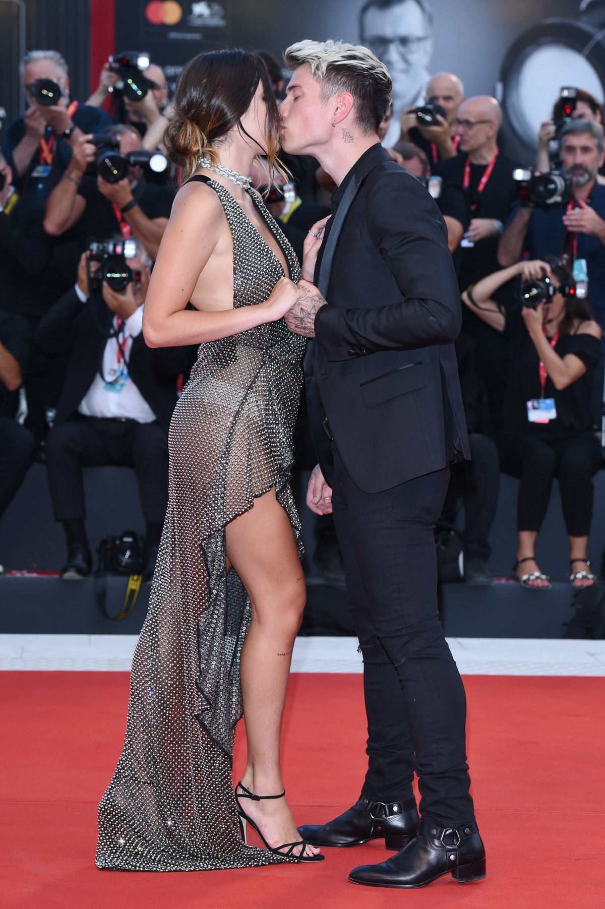 """VENICE, ITALY - AUGUST 31: Bella Thorne and Benjamin Mascolo walk the red carpet ahead of the """"Joker..."""