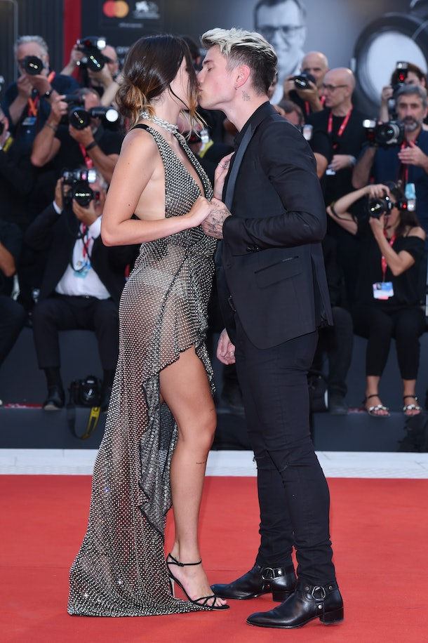 """VENICE, ITALY - AUGUST 31: Bella Thorne and Benjamin Mascolo walk the red carpet ahead of the """"Joker"""" screening during the 76th Venice Film Festival at Sala Grande on August 31, 2019 in Venice, Italy. (Photo by Stefania D'Alessandro/WireImage,)"""