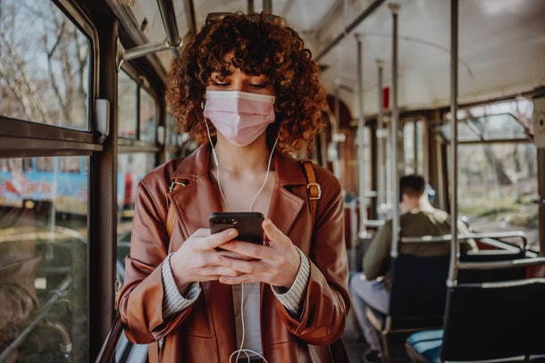 Young woman in public transportation during the pandemic