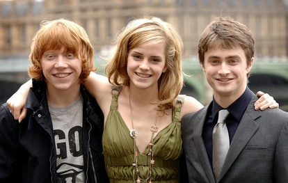 The cast of Harry Potter And The Order Of The Phoenix, (left to right) Rupert Grint, Emma Watson, and Daniel Radcliffe, on the Thames Terrace of County Hall in south London, ahead of the European premiere of the film next week.   (Photo by Joel Ryan - PA Images/PA Images via Getty Images)