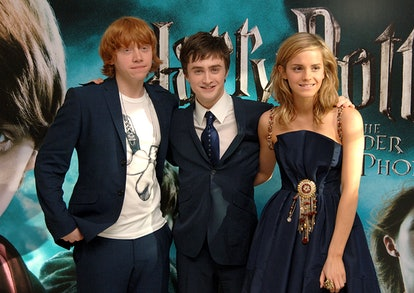 (L-R) Rupert Grint, Daniel Radcliffe and Emma Watson arrive for the UK Premiere of Harry Potter And The Order Of The Phoenix at the Odeon Leicester Square, central London.   (Photo by Ian West - PA Images/PA Images via Getty Images)