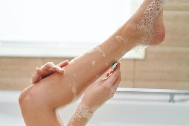 woman shaving leg