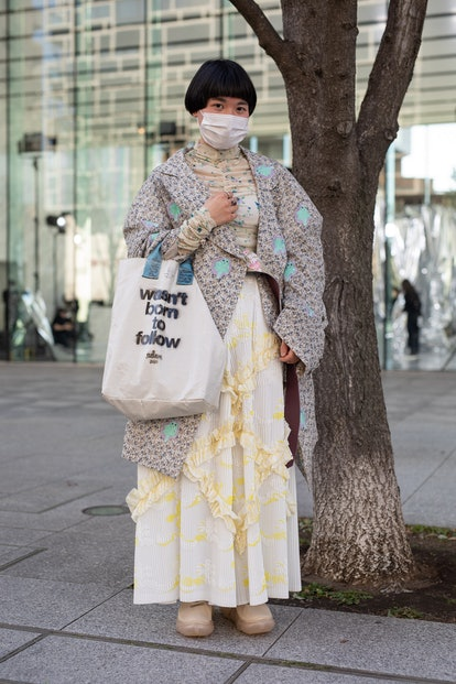 TOKYO, JAPAN - MARCH 15: A guest is seen on the street wearing Mikio Sakabe outfit, 'wasn't born to ...