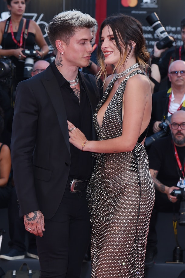 """VENICE, ITALY - AUGUST 31: Benjamin Mascolo and Bella Thorne walk the red carpet ahead of the """"Joker"""" screening during the 76th Venice Film Festival at Sala Grande on August 31, 2019 in Venice, Italy. (Photo by Stefania D'Alessandro/WireImage,)"""
